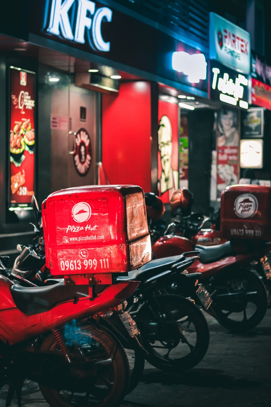 photo of motorcycles parked near fast food restaurants